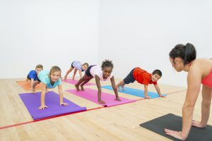 Group of children in yoga class.
